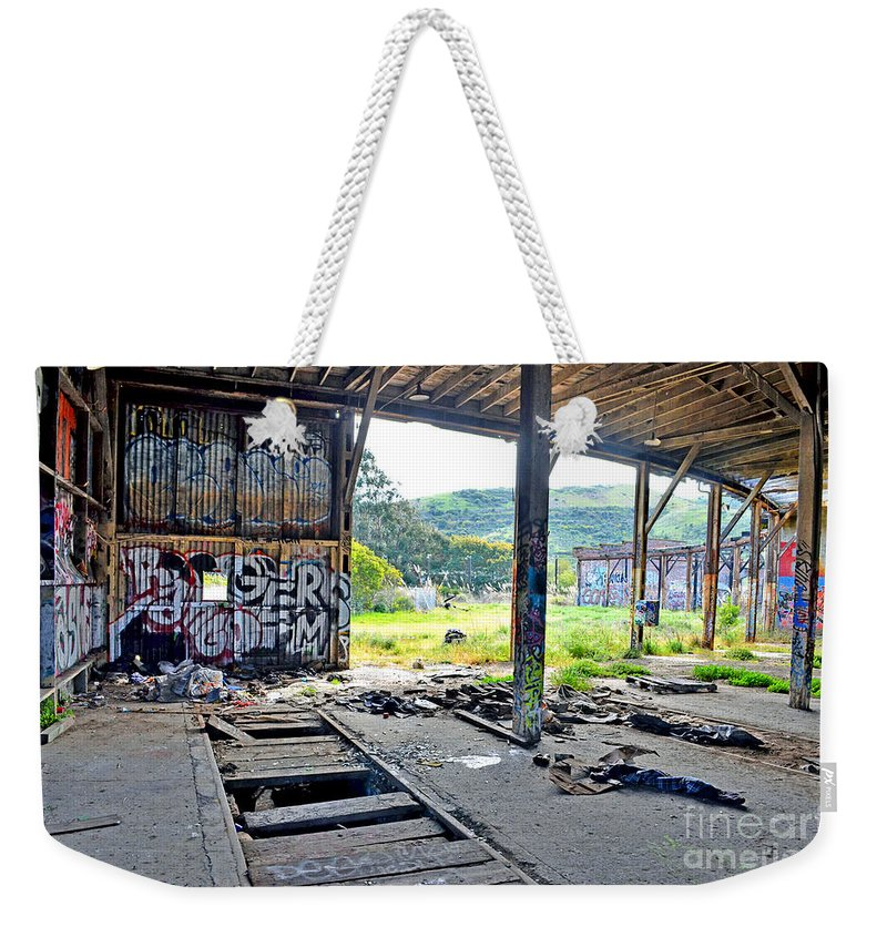 Destroyed Weekender Tote Bag featuring the photograph Inside The Old Train Roundhouse At Bayshore Near San Francisco And The Cow Palace Iv by Jim Fitzpatrick