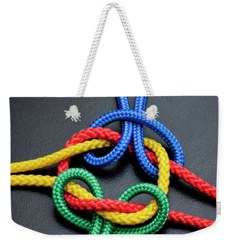 Teamwork Weekender Tote Bag featuring the photograph Intertwined Multicolored Ropes by Jorg Greuel