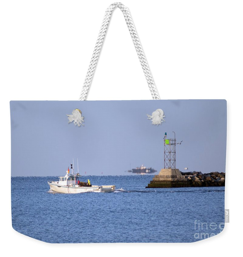 Boat Weekender Tote Bag featuring the photograph Into The Blue by Joe Geraci