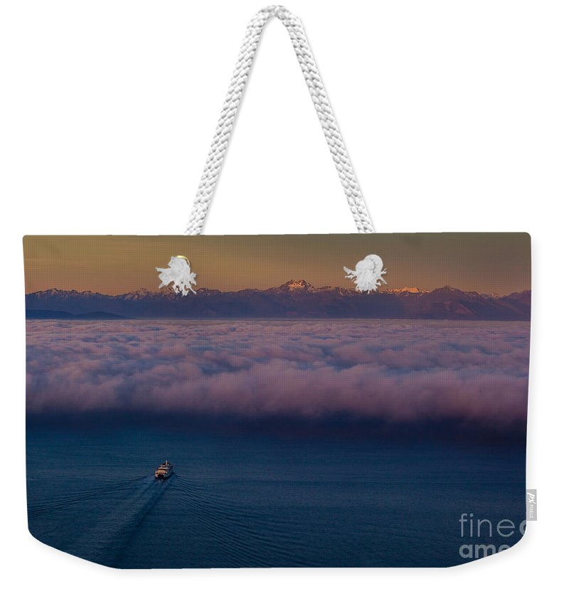 Seattle Weekender Tote Bag featuring the photograph Into The Mist by Mike Reid