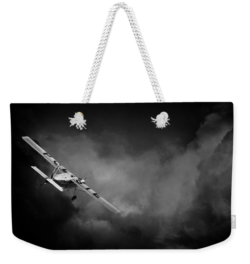 Pilatus Pc6 Porter Weekender Tote Bag featuring the photograph Into The Storm by Paul Job