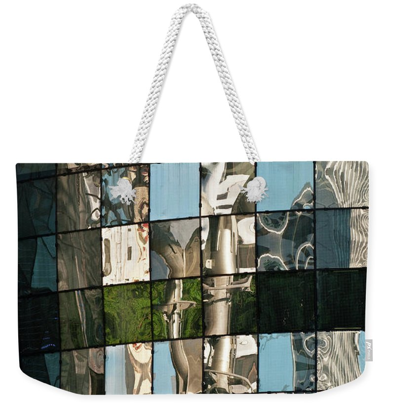 Singapore Weekender Tote Bag featuring the photograph Ion Orchard Reflections by Rick Piper Photography