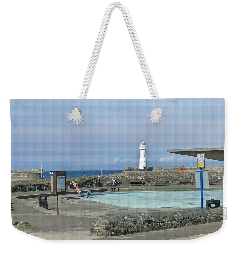 Irish Weekender Tote Bag featuring the photograph Irish Sea Lighthouse On Pier by Brenda Brown