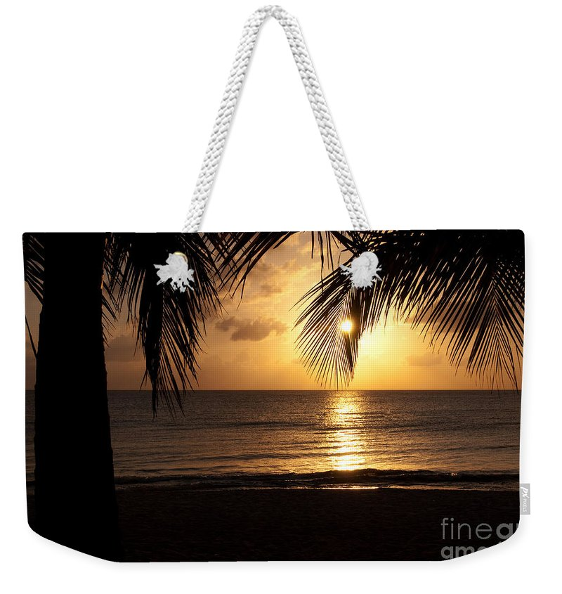 Island Weekender Tote Bag featuring the photograph Island Sunset by Charles Dobbs