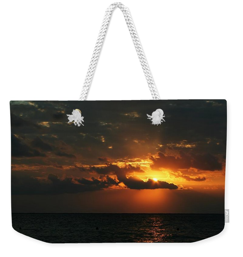 Cozumel Weekender Tote Bag featuring the photograph It Burns by Laurie Search