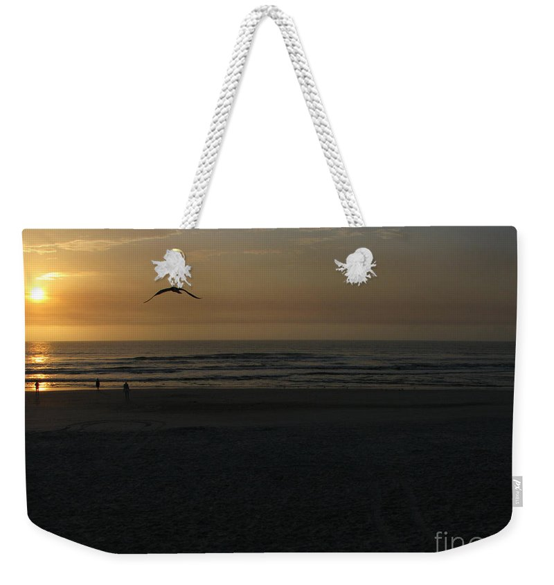 Florida Sunrise Weekender Tote Bag featuring the photograph It Starts by Greg Patzer