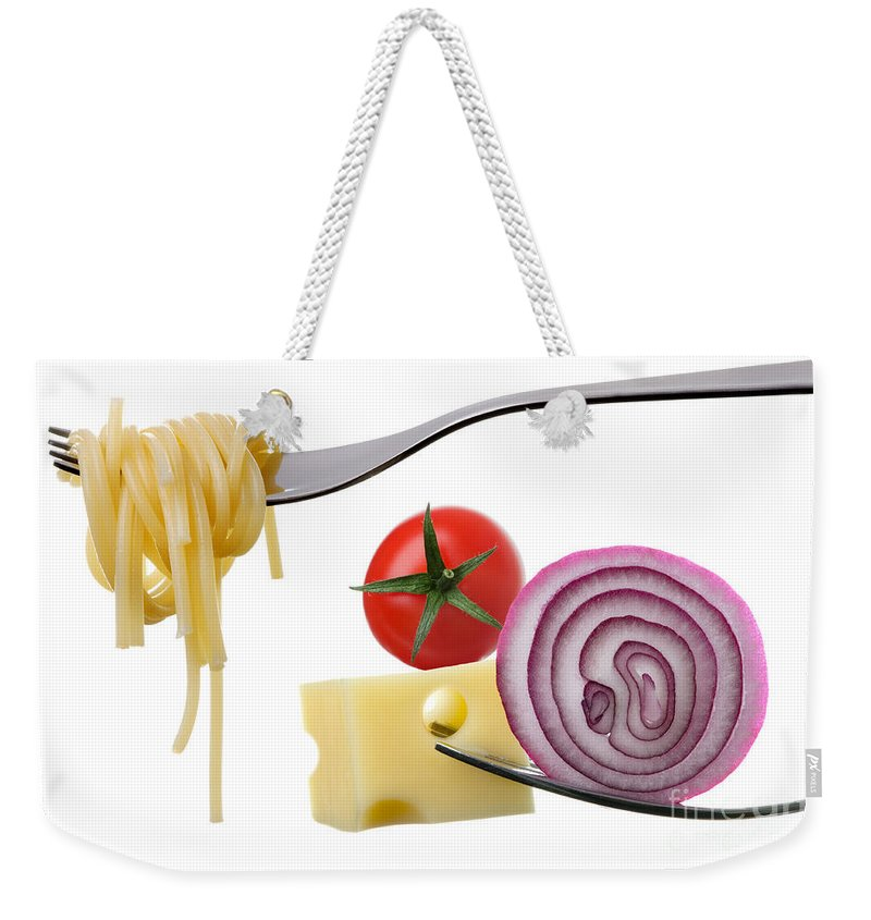 Spaghetti Weekender Tote Bag featuring the photograph Italian Food Ingredients On Forks Against White by Lee Avison