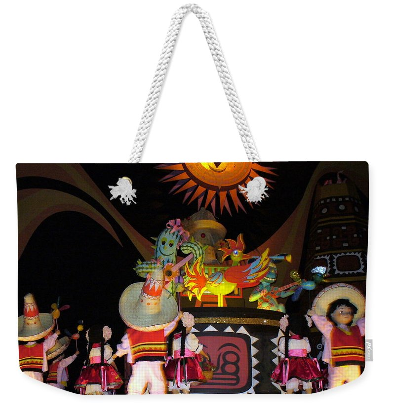 It's A Small World Ride Weekender Tote Bag featuring the photograph It's A Small World With Dancing Mexican Character by Lingfai Leung