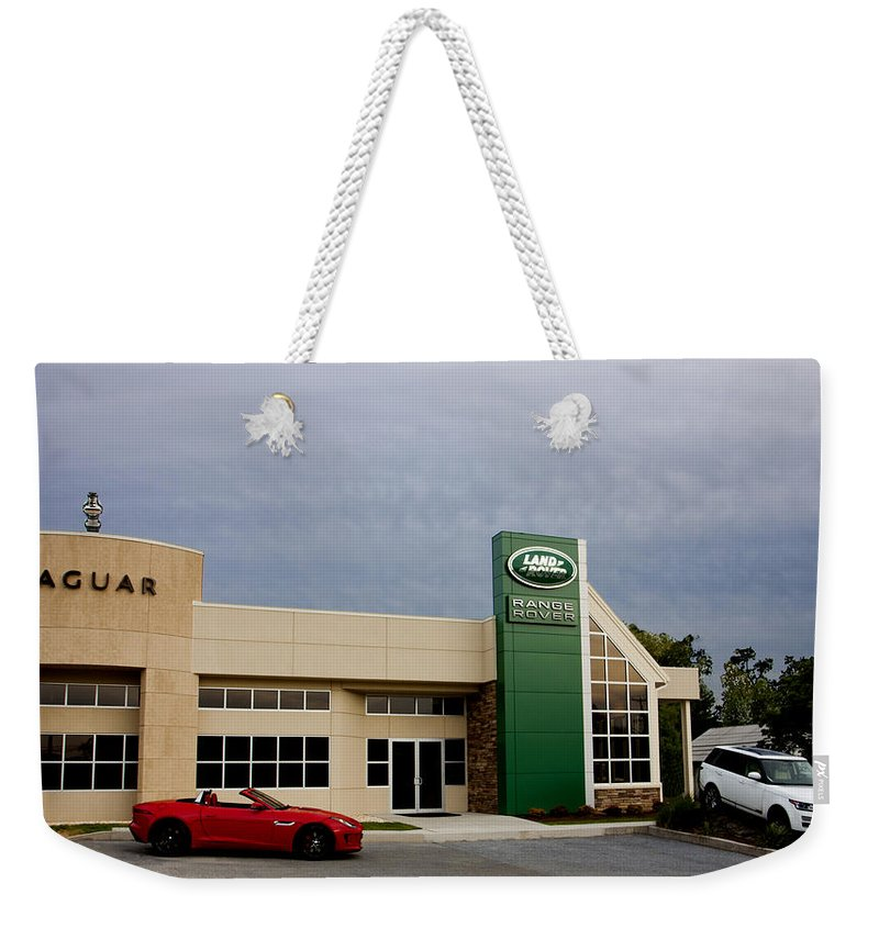 Jaguar Weekender Tote Bag featuring the photograph Jaguar Land Rover At Dusk by Jean Macaluso