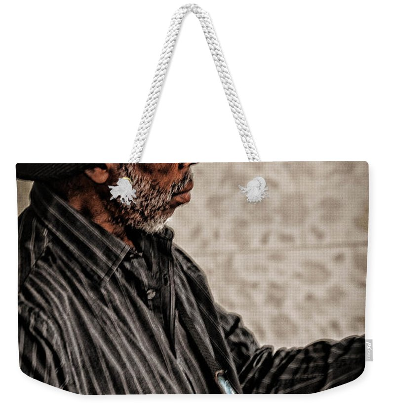 Guitar Weekender Tote Bag featuring the photograph Jamming On The Street by Jon Cody