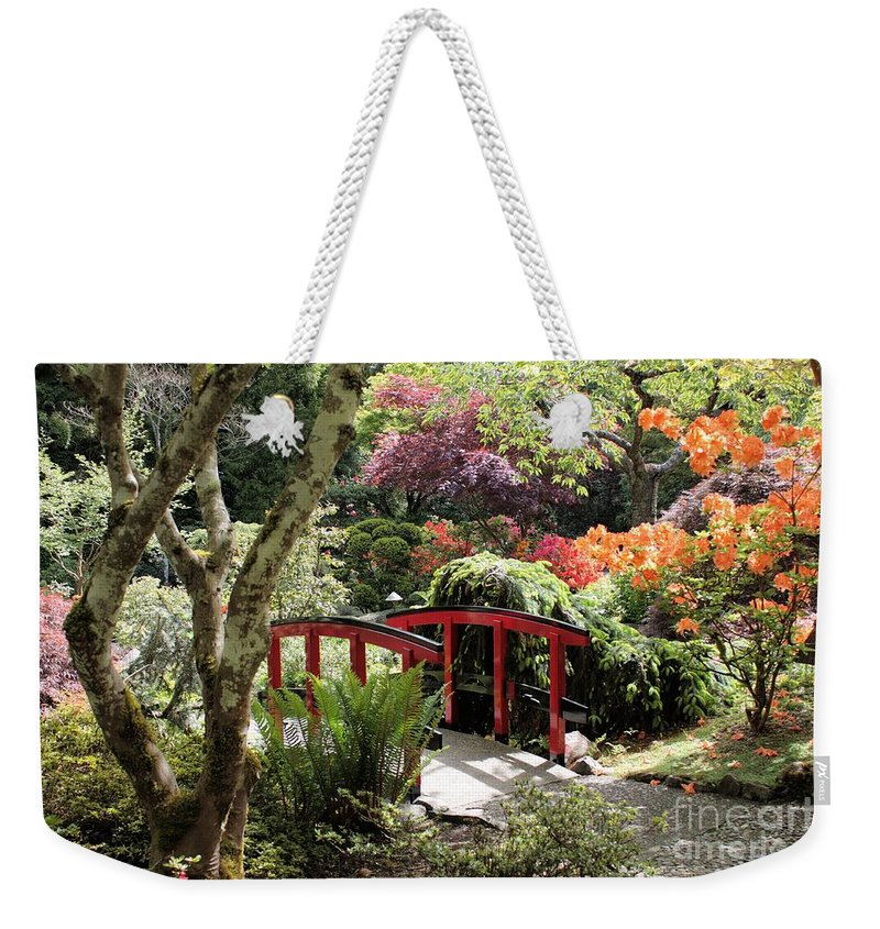 Japanese Garden Weekender Tote Bag featuring the photograph Japanese Garden Bridge With Rhododendrons by Carol Groenen