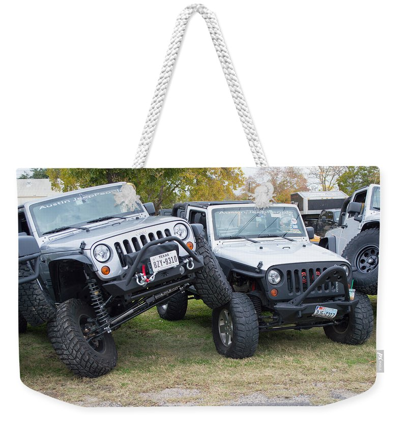 Leander Car Show Weekender Tote Bag featuring the photograph Jeeps In Juxtaposition by JG Thompson
