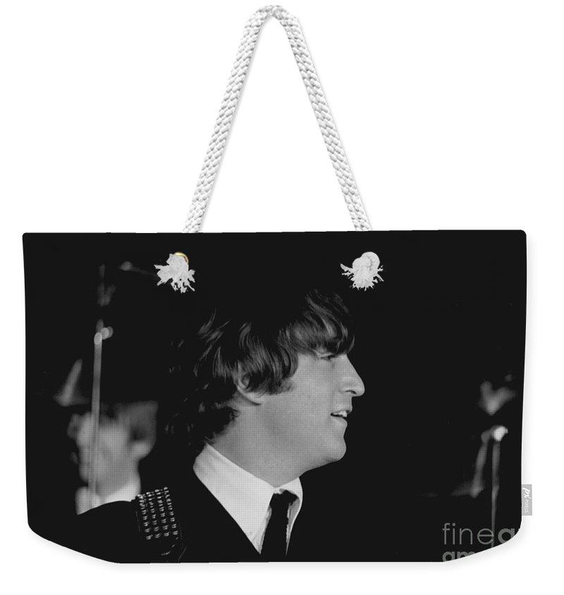 Beatles Weekender Tote Bag featuring the photograph John Lennon, Beatles Concert, 1964 by Larry Mulvehill