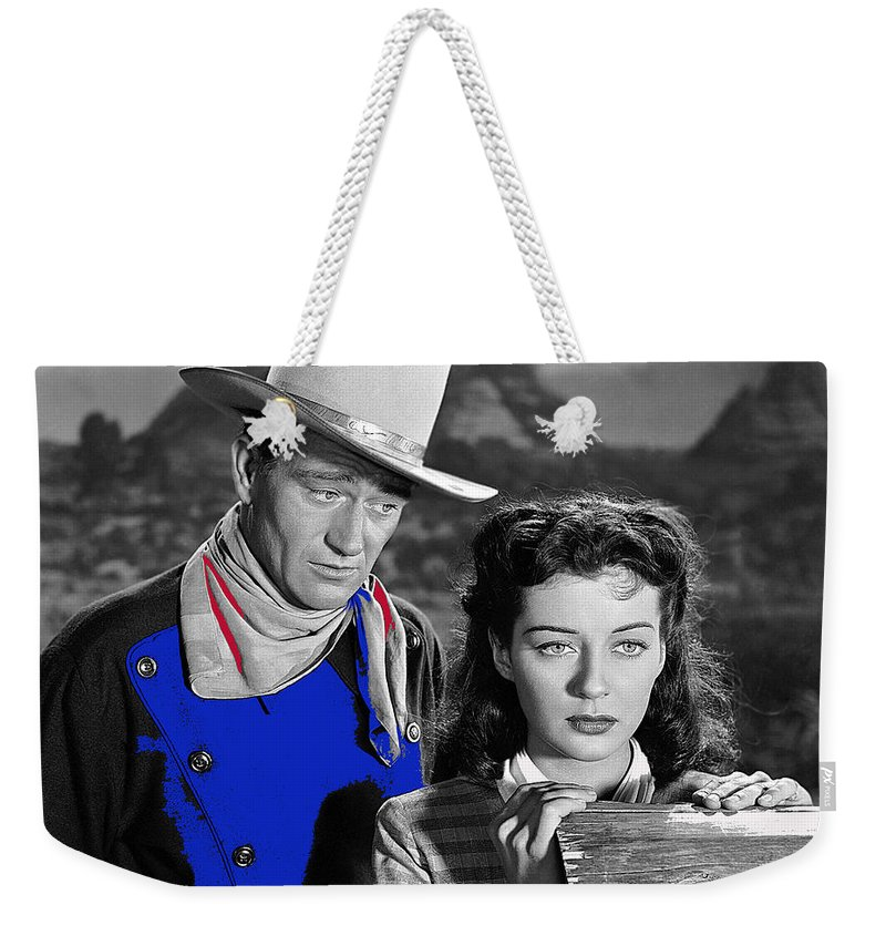John Wayne Gail Russell Angel And The Badman Publicity Photo 1947 Weekender Tote Bag featuring the photograph John Wayne Gail Russell Angel And The Badman Publicity Photo 1947-2012 by David Lee Guss