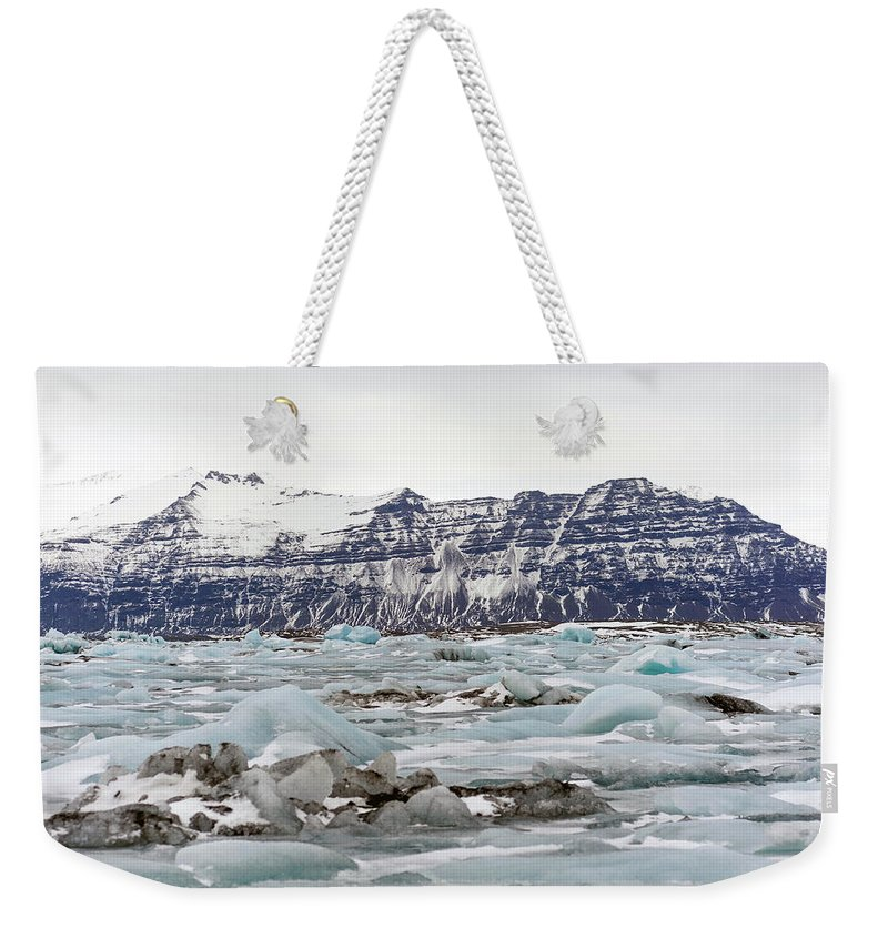 Tranquility Weekender Tote Bag featuring the photograph Jokulsarlon by Photo By Dave Moore