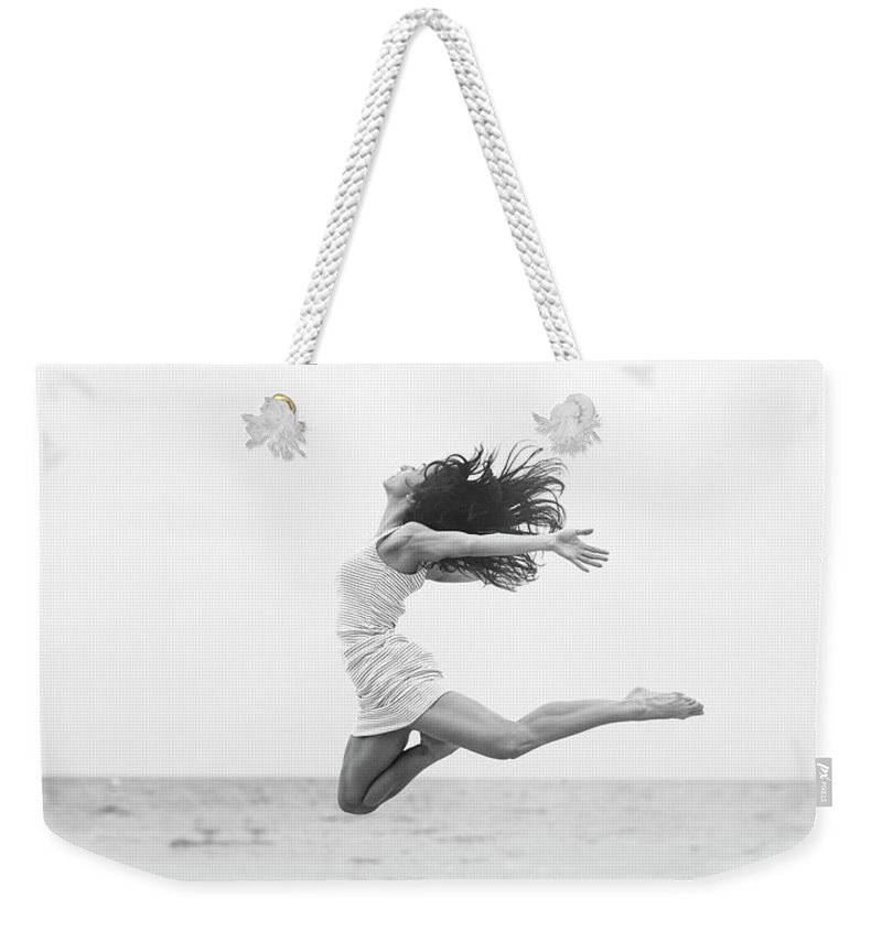 People Weekender Tote Bag featuring the photograph Jumping At The Beach by Srdjana1