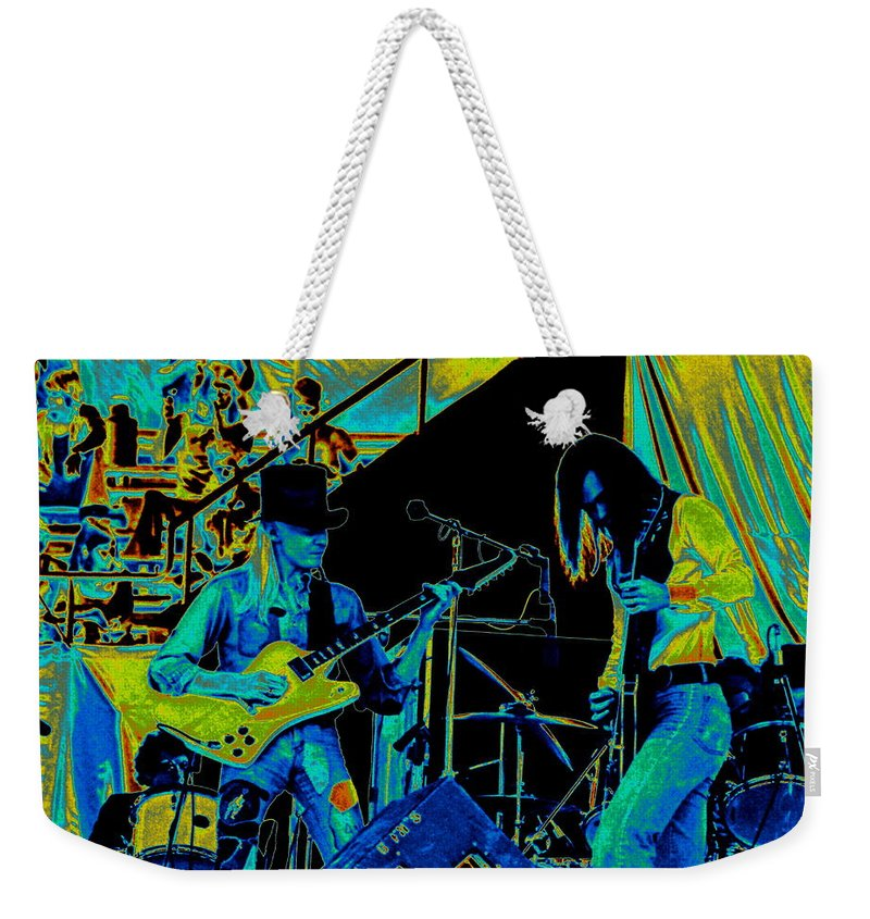 Johnny Winter Weekender Tote Bag featuring the photograph Jwinter #6 In Cosmicolors by Ben Upham