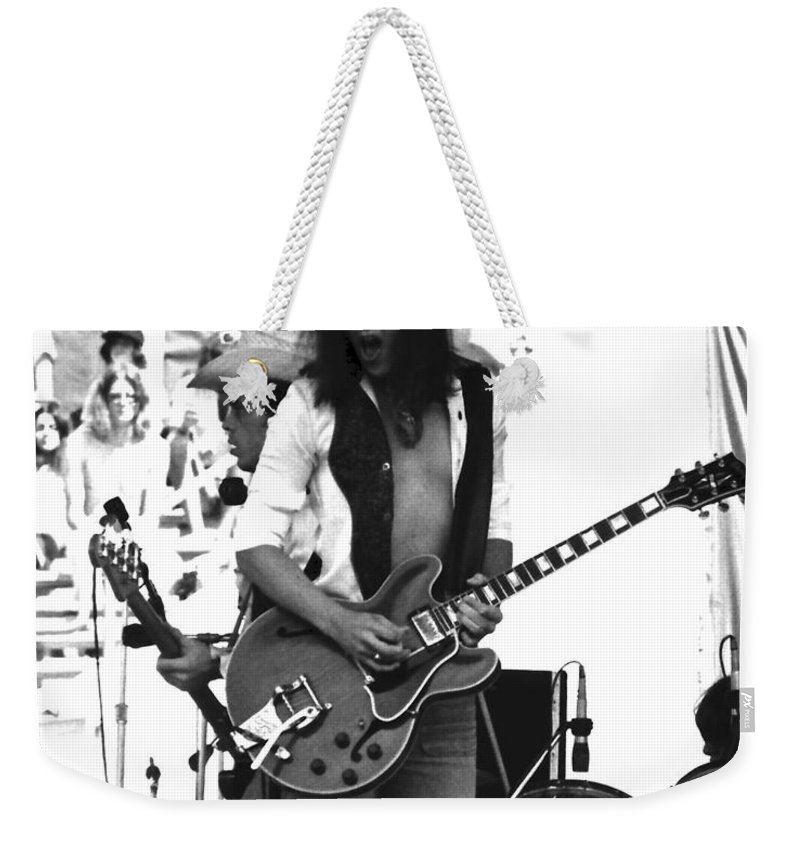 Johnny Winter Weekender Tote Bag featuring the photograph Jwinter #8 by Ben Upham