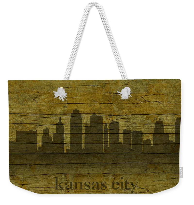 Kansas Weekender Tote Bag featuring the mixed media Kansas City Missouri City Skyline Silhouette Distressed On Worn Peeling Wood by Design Turnpike
