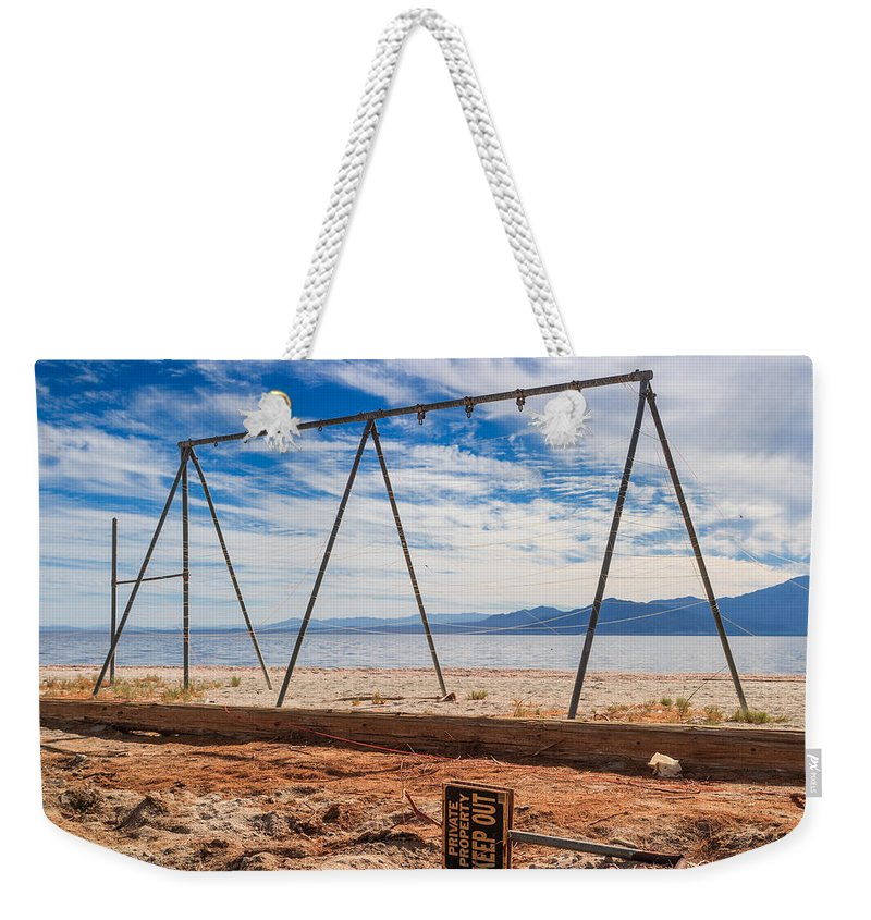 Salton Sea Weekender Tote Bag featuring the photograph Keep Out No Playing Here Swing Set Playground by Scott Campbell