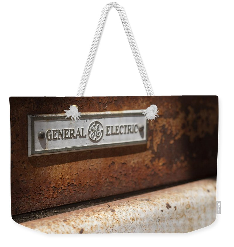 General Electric Weekender Tote Bag featuring the photograph Keeping Rusty Company by Scott Campbell