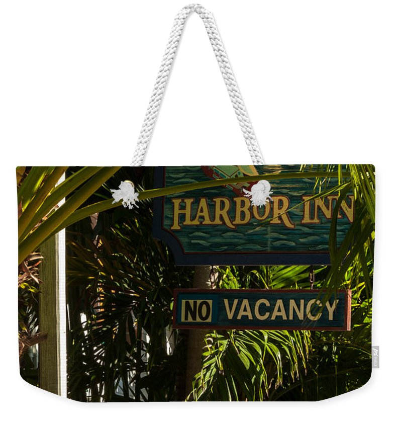 Architecture Weekender Tote Bag featuring the photograph Key West Harbor Inn Sign by Ed Gleichman