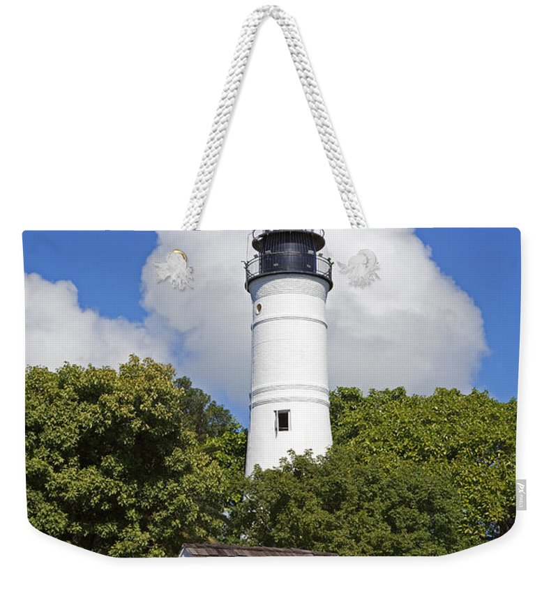 Key West Weekender Tote Bag featuring the photograph Key West Lighthouse by John Stephens