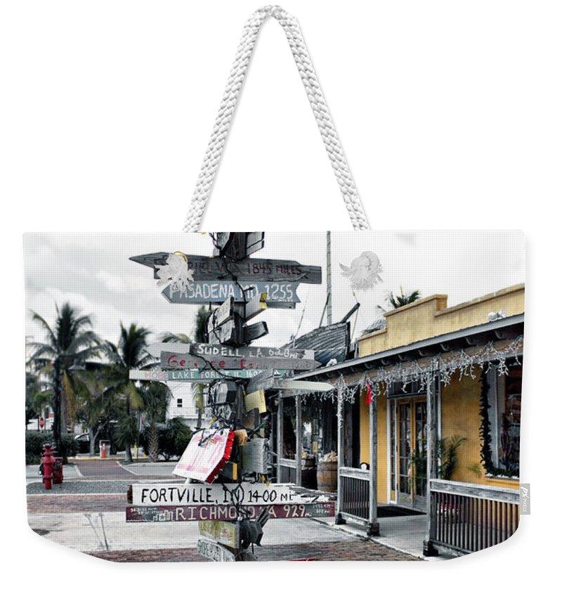 Key West Weekender Tote Bag featuring the photograph Key West Wharf by Ellen Heaverlo