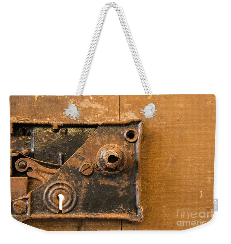 Lock Mechanism Weekender Tote Bag featuring the photograph Keyhole     by Bob Phillips