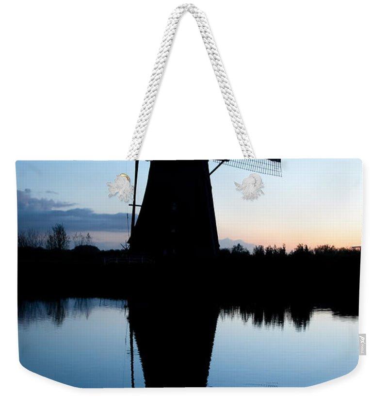 Kinderdijk Weekender Tote Bag featuring the photograph Kinderdijk Dawn by Dave Bowman