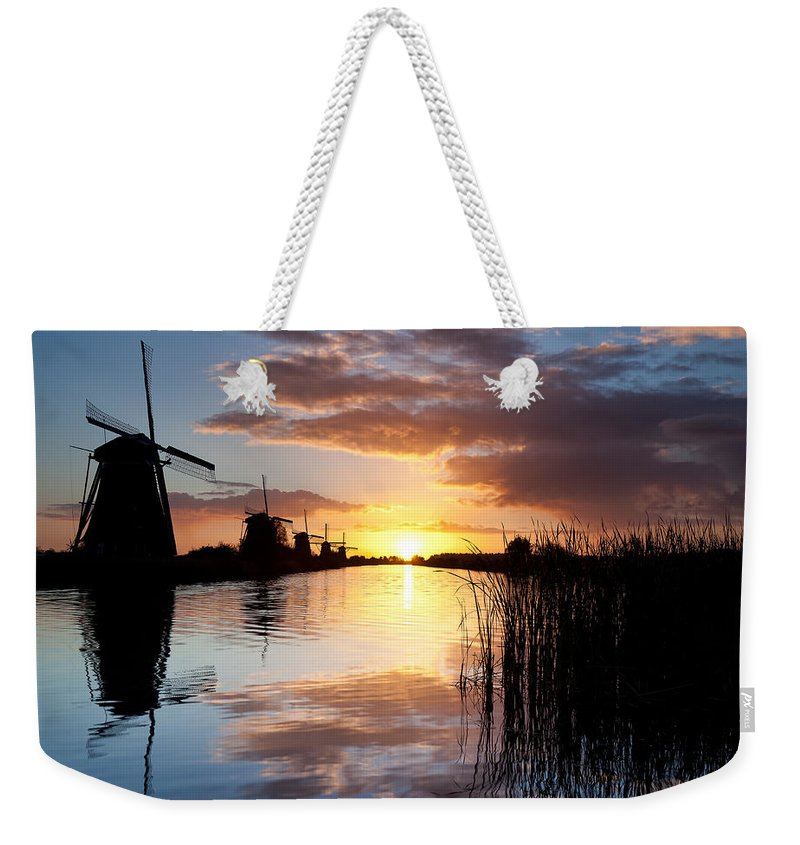 Kinderdijk Weekender Tote Bag featuring the photograph Kinderdijk Sunrise by Dave Bowman