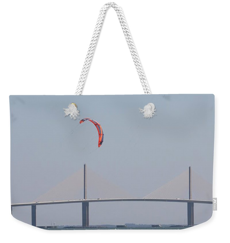 Bridge Weekender Tote Bag featuring the photograph Kite Surfer And Skyway Bridge by Christiane Schulze Art And Photography