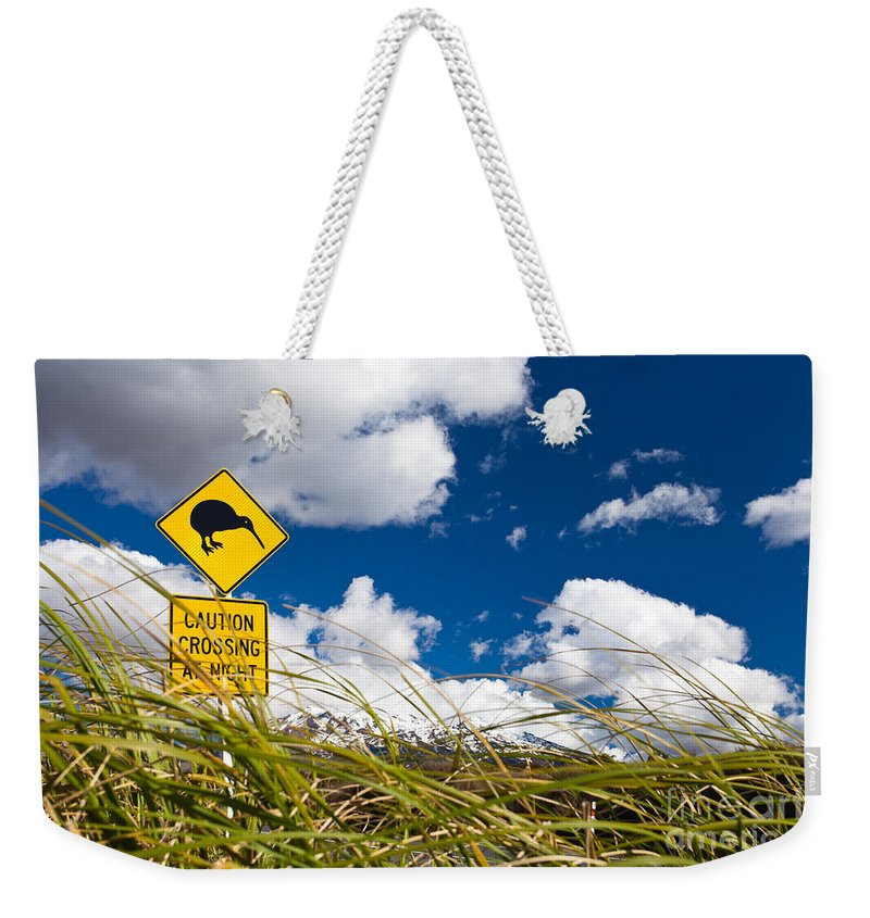 Mount Weekender Tote Bag featuring the photograph Kiwi Crossing Road Sign In Nz by Stephan Pietzko