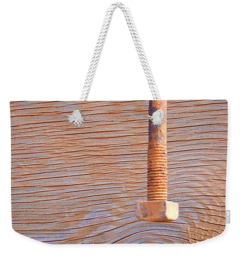 Knothole Weekender Tote Bag featuring the photograph Knothole Bolt And Staple by Mary Deal