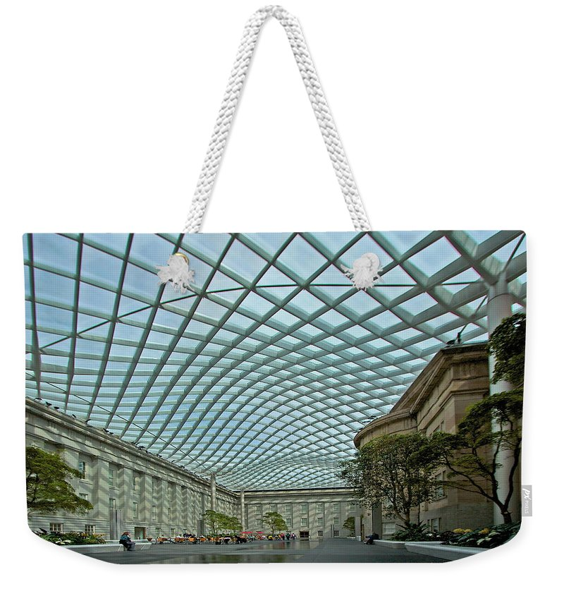 Kogod Weekender Tote Bag featuring the photograph Kogod Courtyard by Stuart Litoff