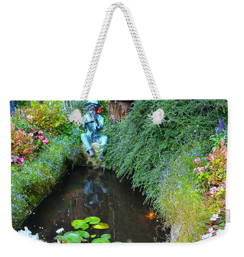 Photograph Weekender Tote Bag featuring the photograph Koi Fountain by Nicole Parks