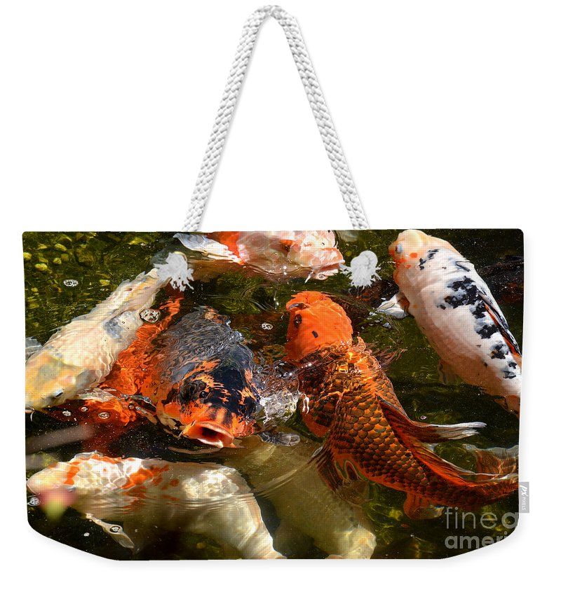 Susan Wiedmann Weekender Tote Bag featuring the photograph Koi Rising by Susan Wiedmann