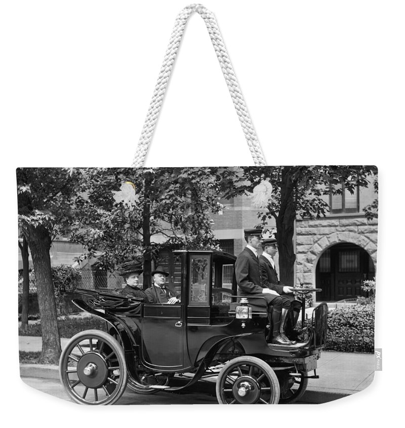 1900's Weekender Tote Bag featuring the photograph Krieger Electric Carriage by Underwood Archives