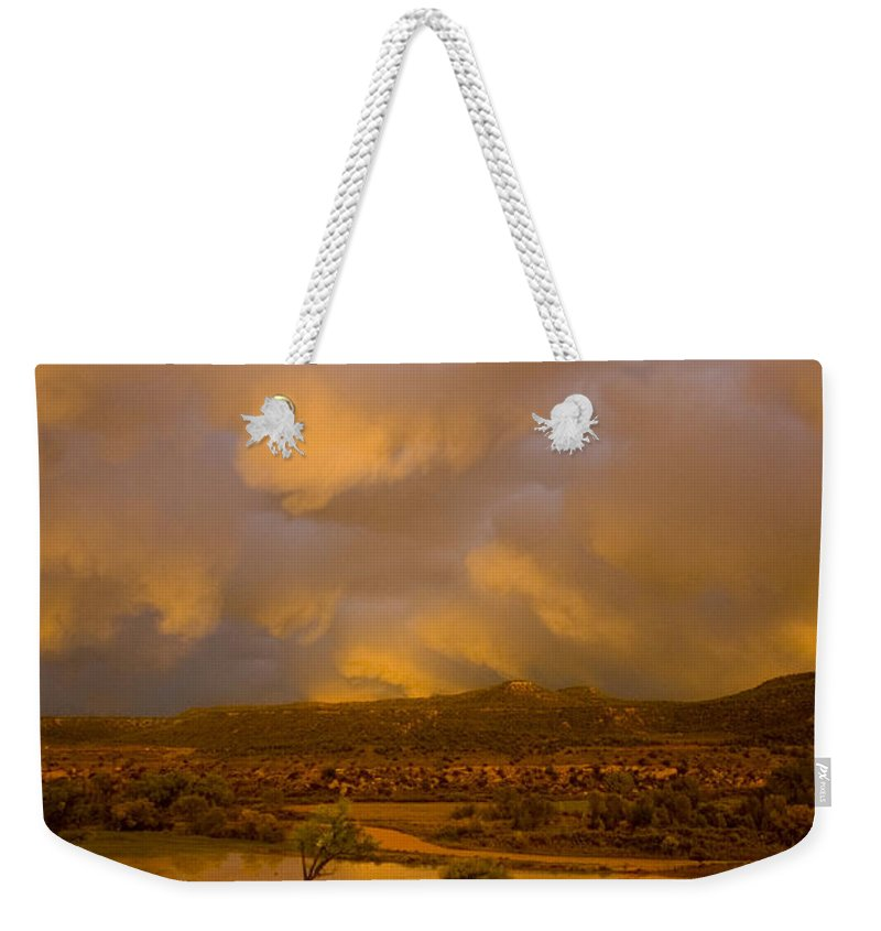 Sunset Weekender Tote Bag featuring the photograph La Boca Rain by Jerry McElroy