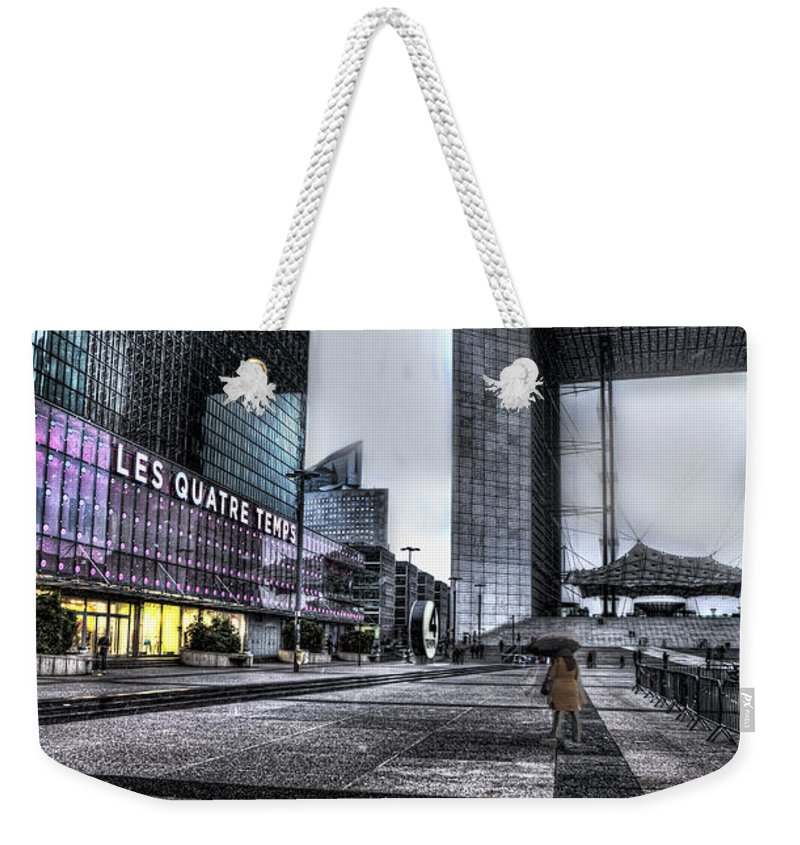 Arch Weekender Tote Bag featuring the photograph La Defense In The Rain by Evie Carrier