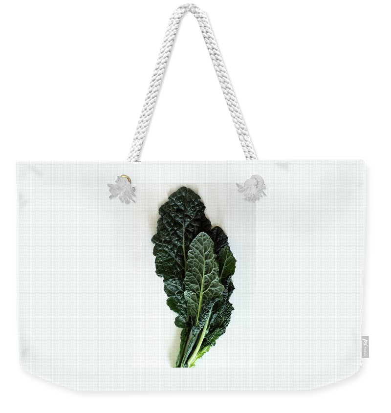 Food Weekender Tote Bag featuring the photograph Lacinato Kale by Romulo Yanes