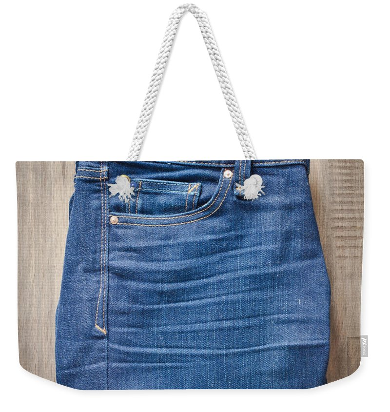 Back Weekender Tote Bag featuring the photograph Ladies' Jeans by Tom Gowanlock
