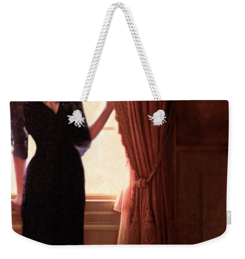 Woman Weekender Tote Bag featuring the photograph Lady In Black By Window by Jill Battaglia