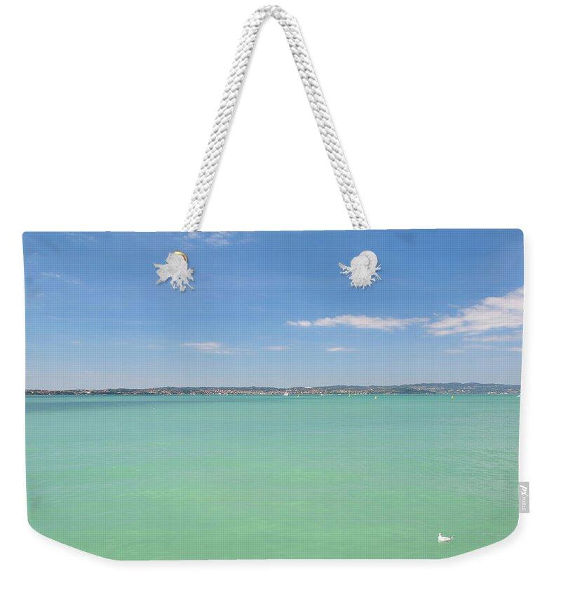 Scenics Weekender Tote Bag featuring the photograph Lago Di Garda by Goranstimac