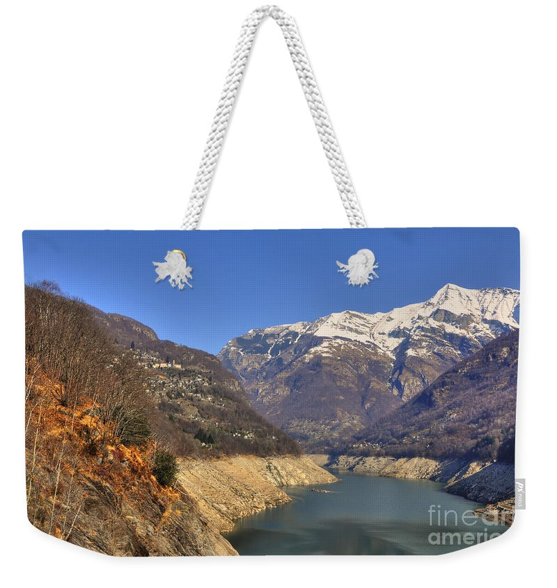 Lake Weekender Tote Bag featuring the photograph Lake And Snow-capped Mountain by Mats Silvan