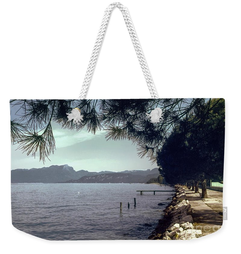 Lakes Garda Mountain Mountains Water Tree Trees Rock Rocks Landscape Landscapes Italy Waterscape Waterscapes Weekender Tote Bag featuring the photograph Lake Garda by Bob Phillips