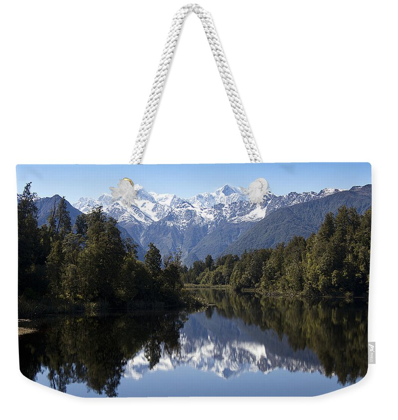 New Zealand Weekender Tote Bag featuring the photograph Lake Matheson New Zealand by Peter Lloyd