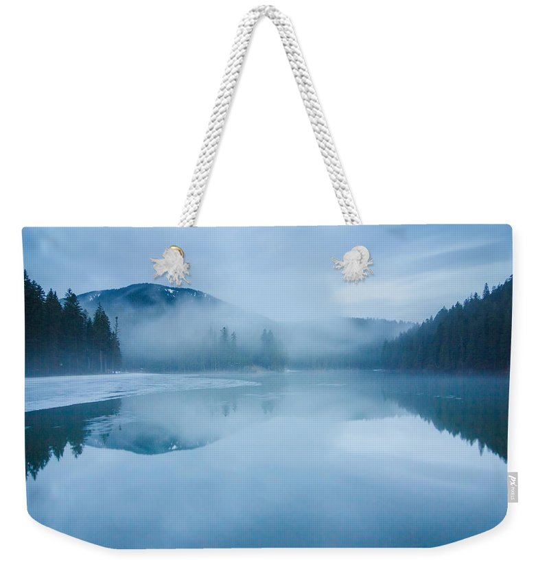 Scenics Weekender Tote Bag featuring the photograph Lake Surrounded By Mountains And Forest by Verybigalex