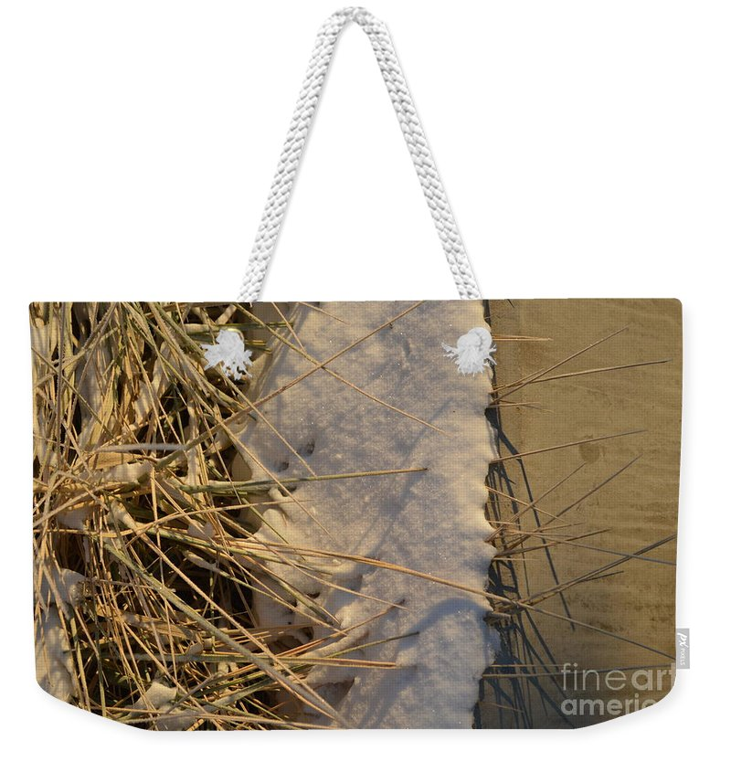 Lance Weekender Tote Bag featuring the photograph Lanceing Through The Layers by Brian Boyle