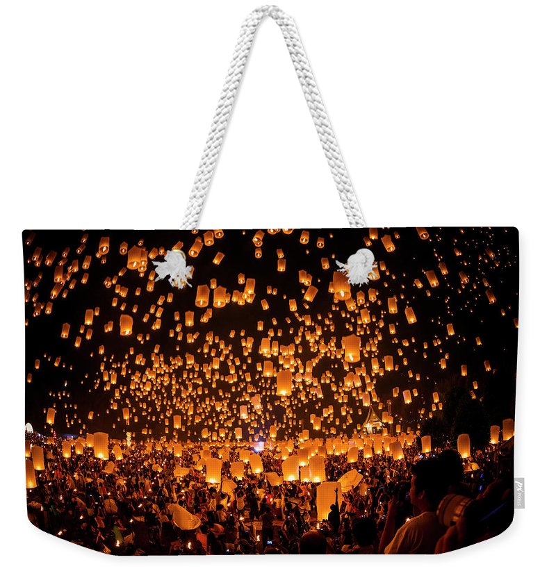 Crowd Weekender Tote Bag featuring the photograph Lantern Float To The Sky by Athit Perawongmetha